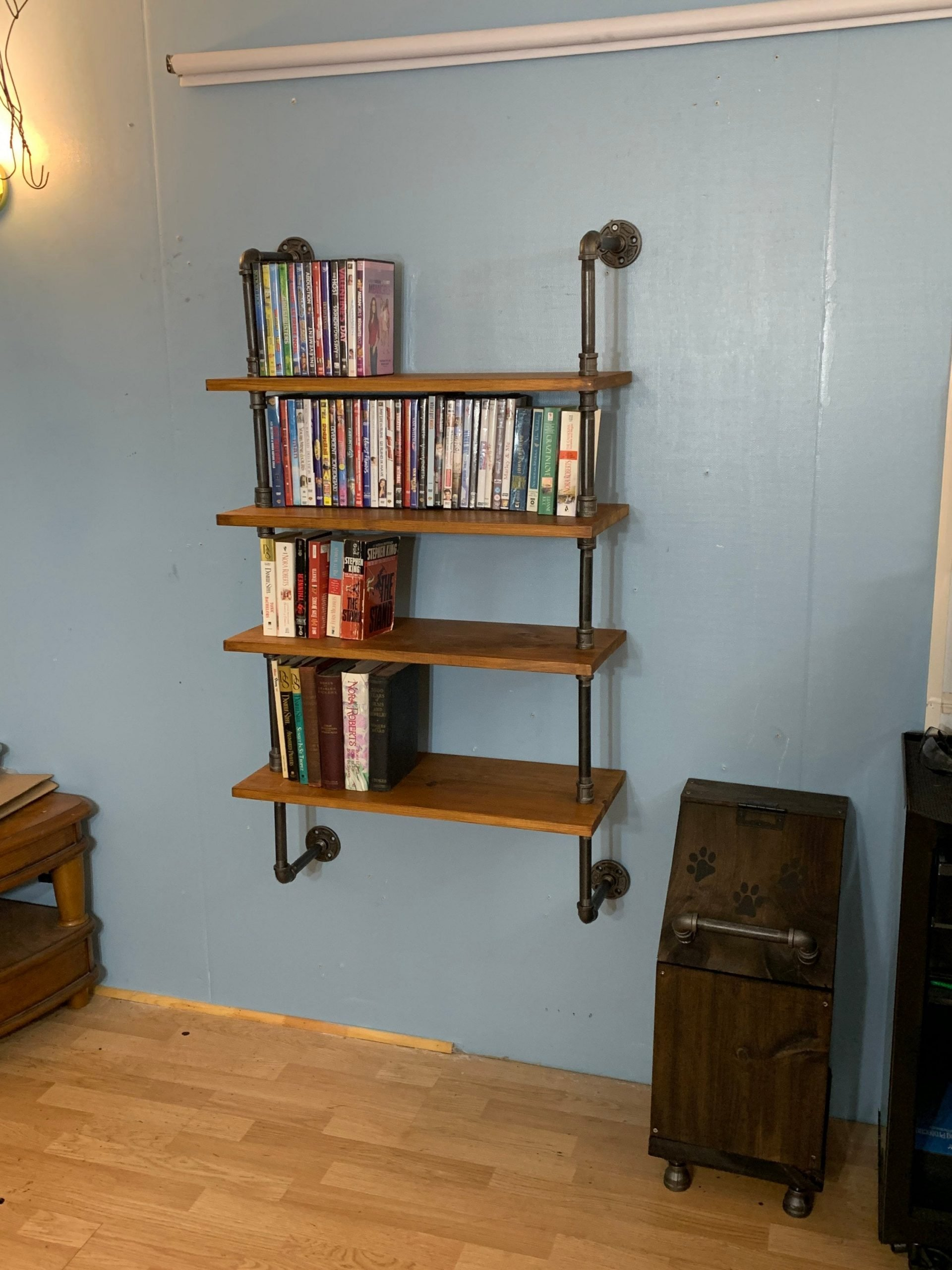 https://pipeworkpieces.com/wp-content/uploads/2021/01/4-tier-wall-mounted-dvd-book-rack-wall-rack-for-dvd-book-case-book-shelf-5ff78aae-scaled.jpg